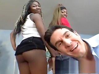 Busty black teens tag team a white cock in an interracial threesome